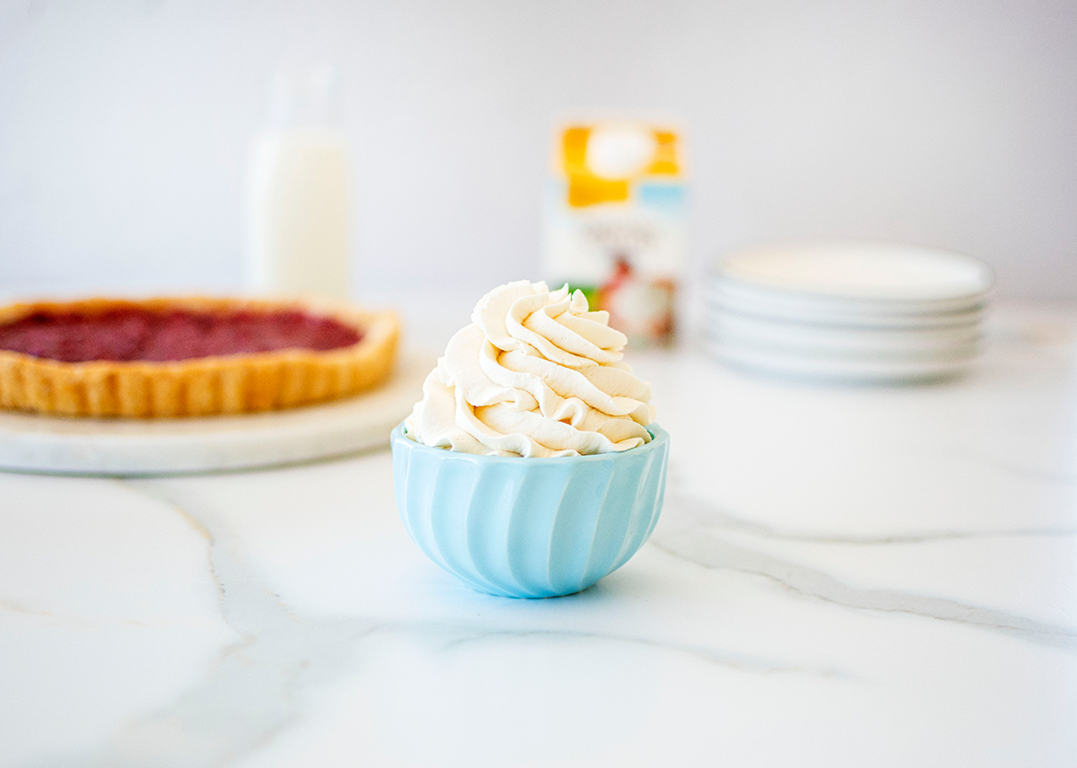 Homemade whipped cream piped in a bowl and ready to eat!