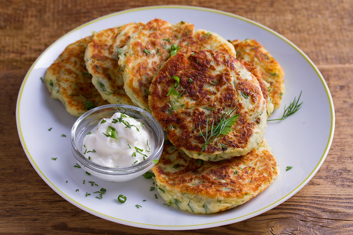 A plate of potatoe pancakes, using leftover mashed potatoes from Thanksgiving dinner.