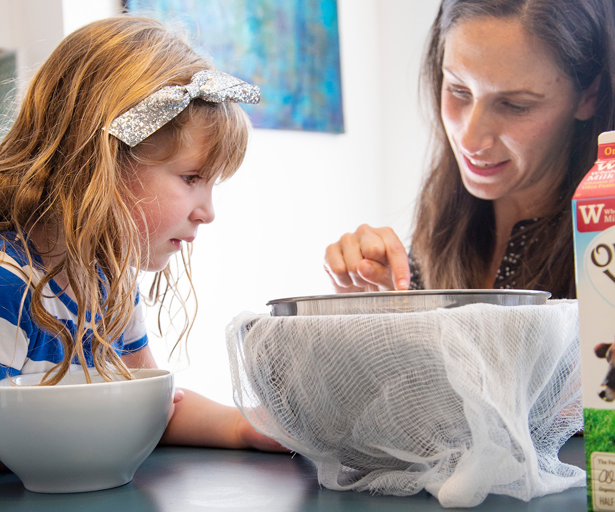 Lauren Manaker and her daughter make homemade ricotta cheese. Photo by Jackie Stofsick.