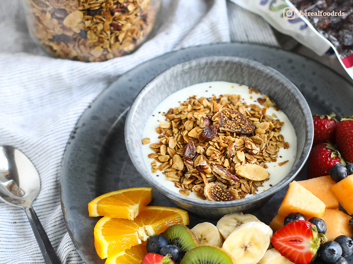 Homemade granola and grass-fed yogurt with fresh fruit on the side. Photo by Real Food Dietitians.