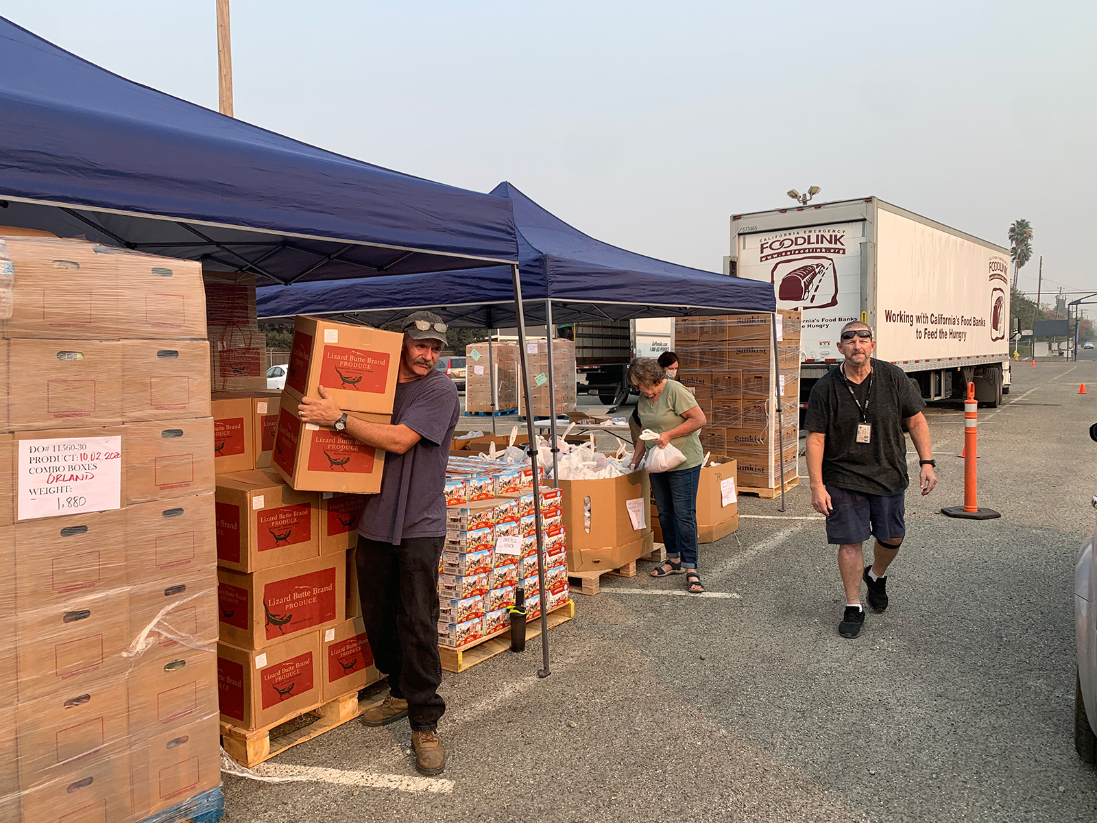 Volunteers share goods and food with community members affecting by the wildfires.