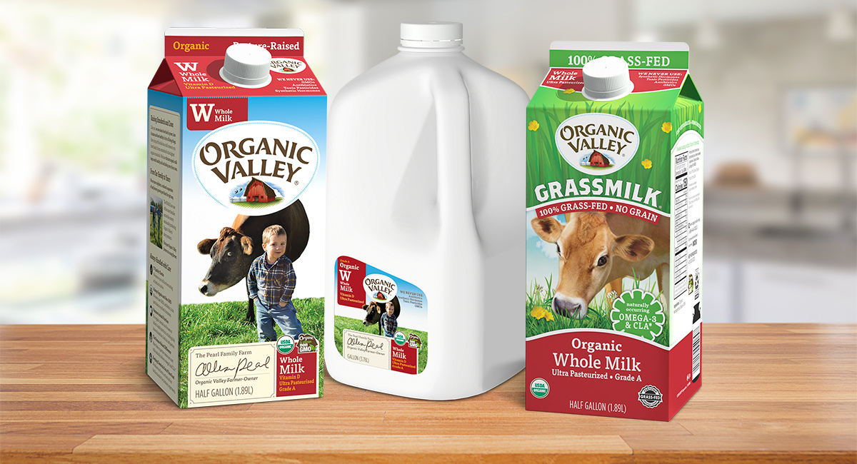 Organic Valley Whole Milk and Grassmilk cartons on a countertop.