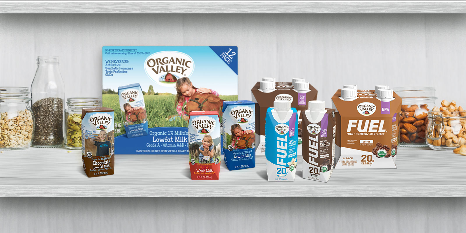 Packages of Organic Valley shelf-stable products displayed on a wooden table.