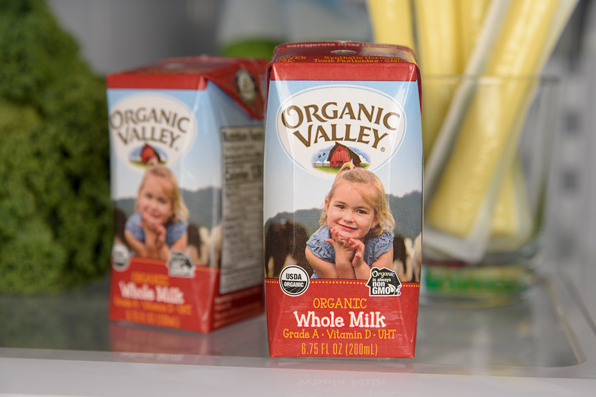 Organic Valley shelf stable milk displayed on a fridge shelf.