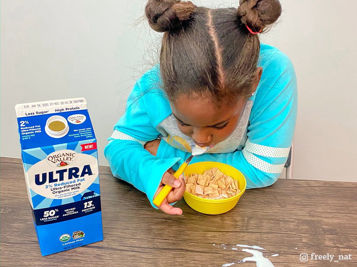 Little girl enjoys cereal with Ultra milk.