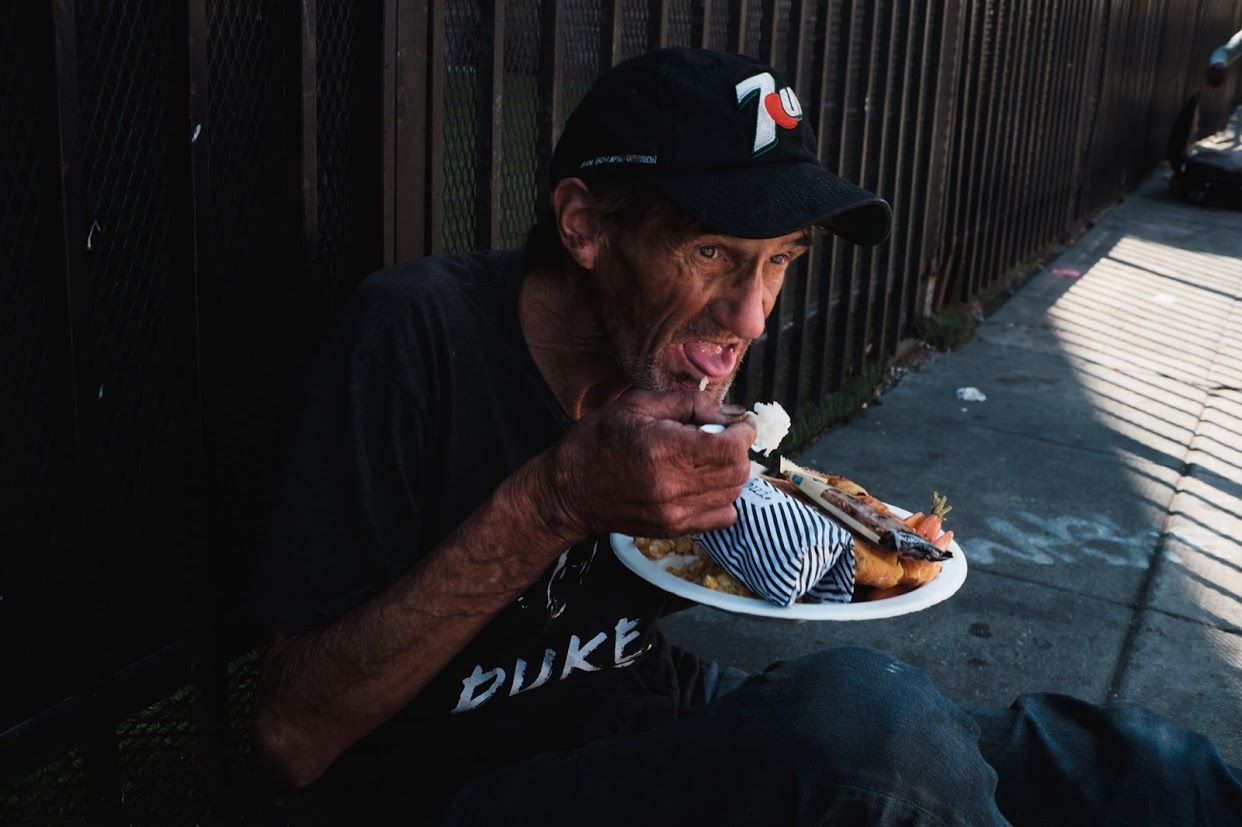 Man receives meal on street