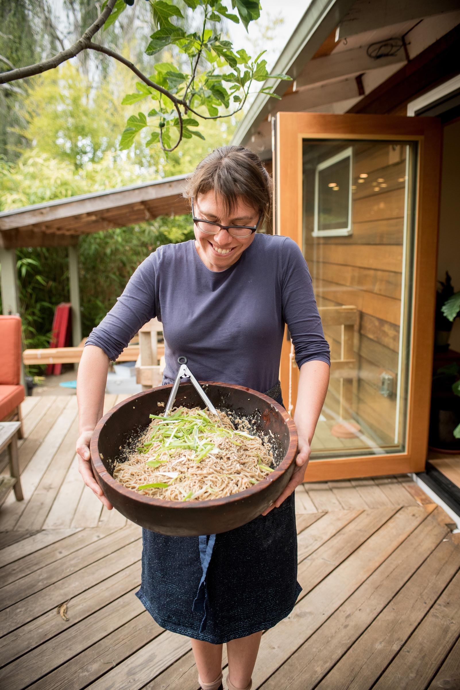 Lola Milholland displays a huge bowl of Umi Organic noodles.