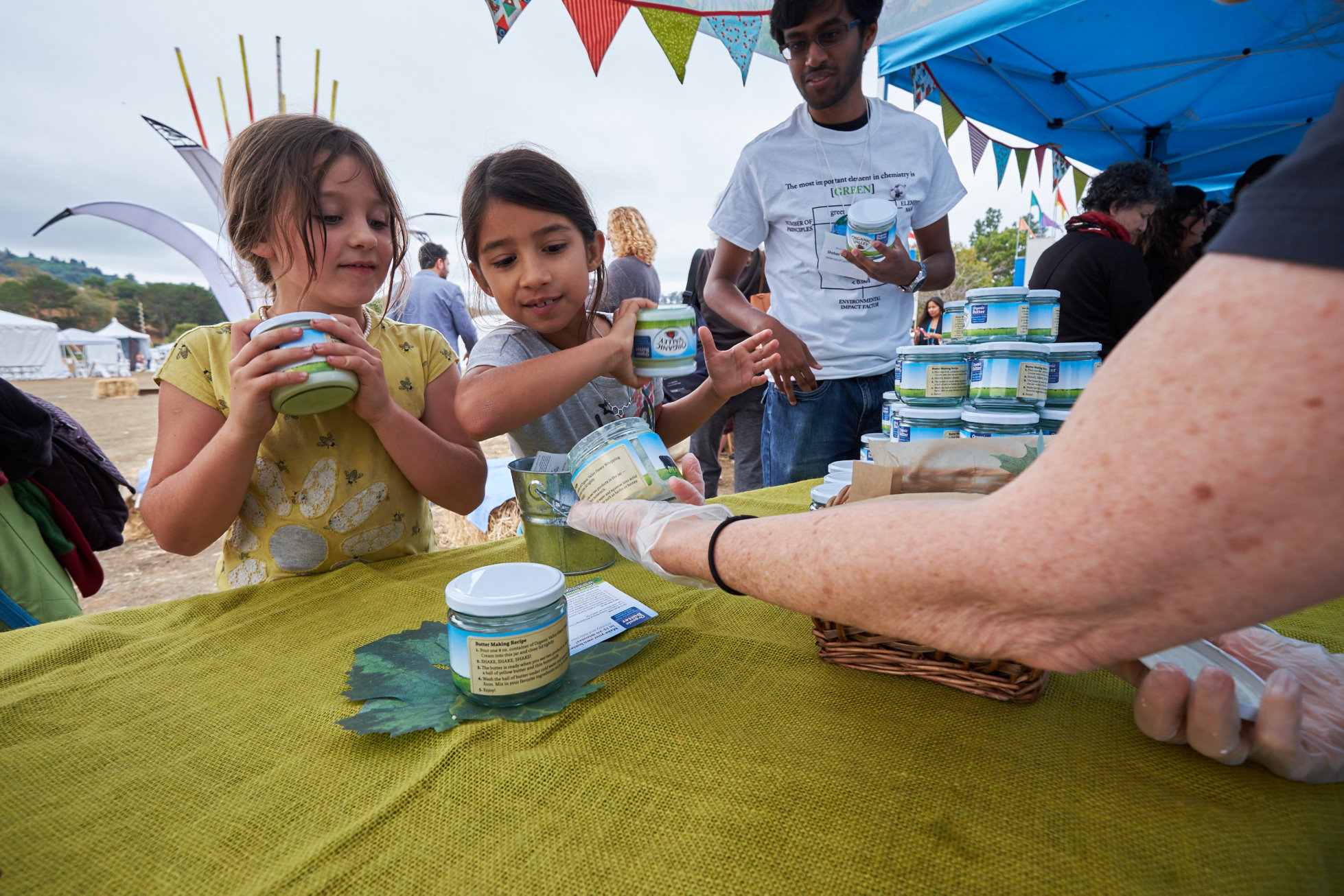 Kids shake up jars of butter from Organic Valley cream at an event.