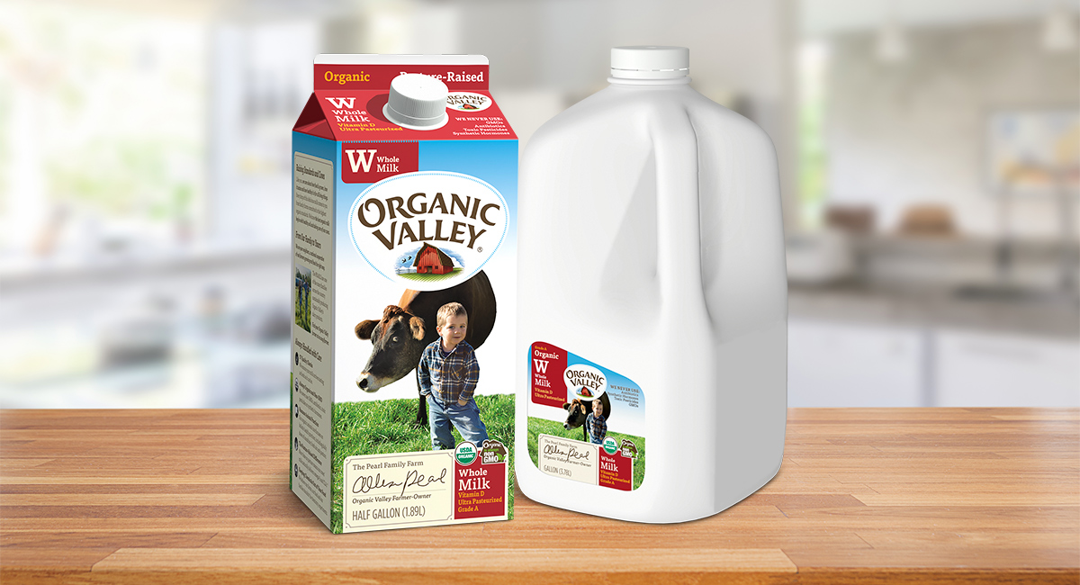 Organic Valley Whole Milk cartons on a countertop.
