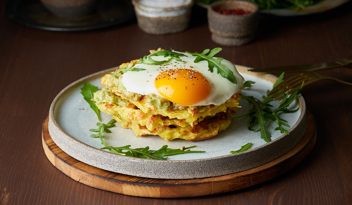Savory waffle using leftover stuffing and topped with a fried egg.