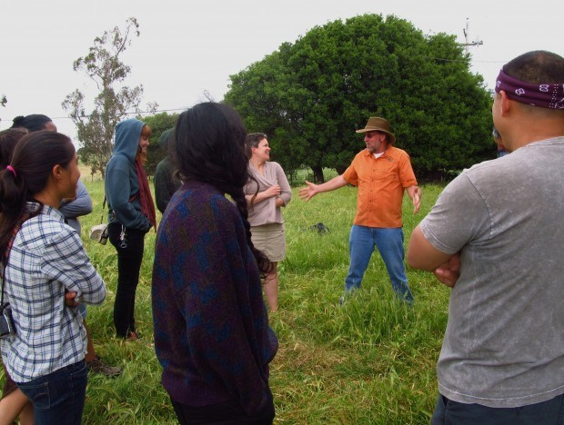 Dr. Guy speaks to a tour group about why high quality pasture is vital to animal health during a pasture walk.