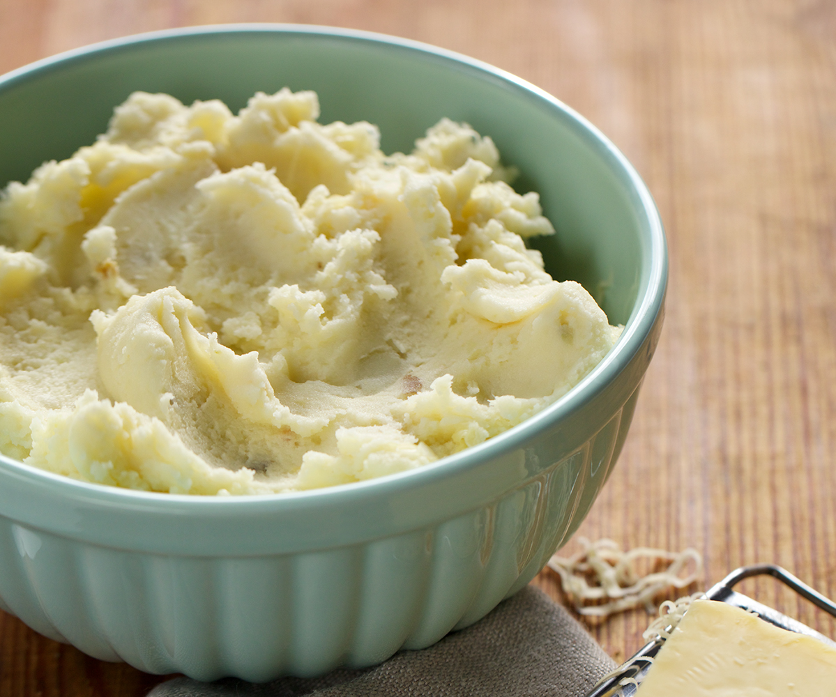 A bowl of mashed potatoes arranged with artful swoops.