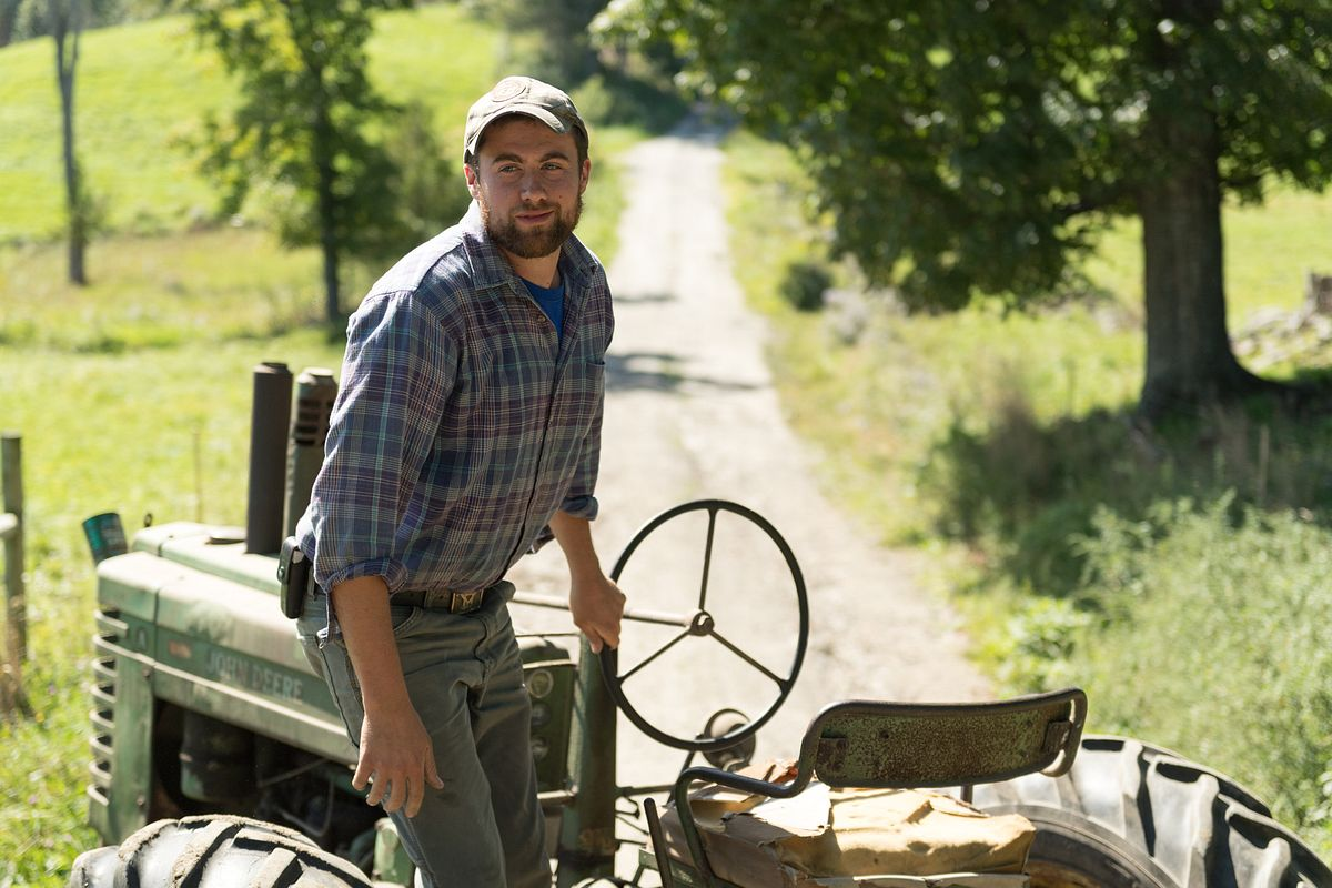 Henry Pearl, who has an organic farm in Vermont, hops off a tractor.