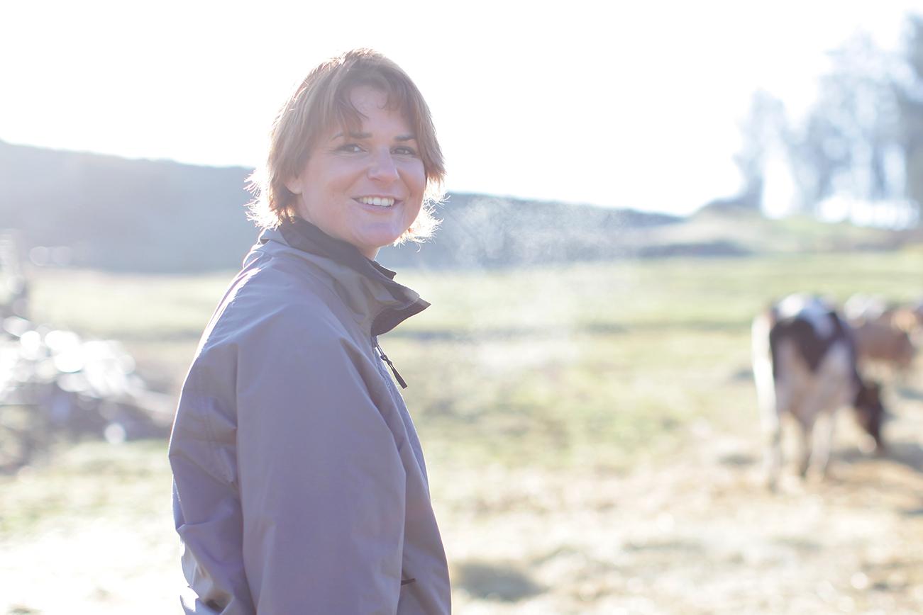 Organic Valley farmer, Jana McClelland smiles at the camera on their farm in California.