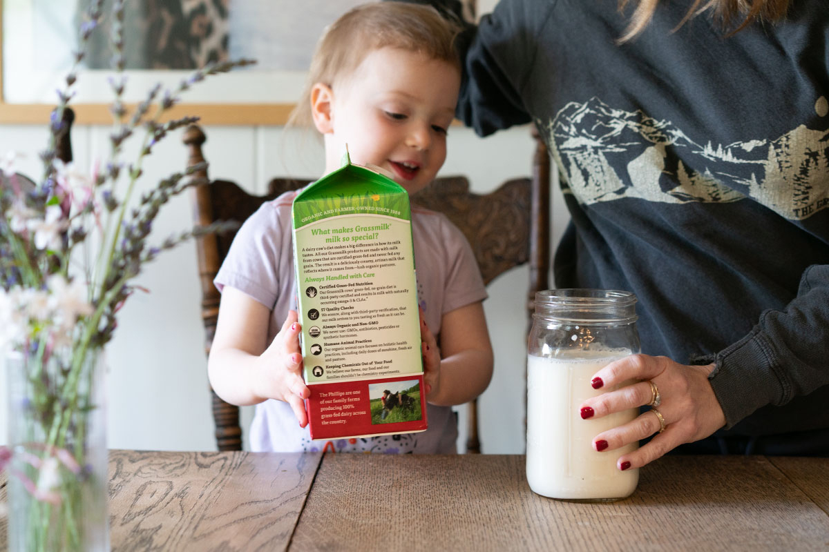 Pouring organic, grass-fed milk into a mason jar. Photo contributed by Amy Rosoff Davis.