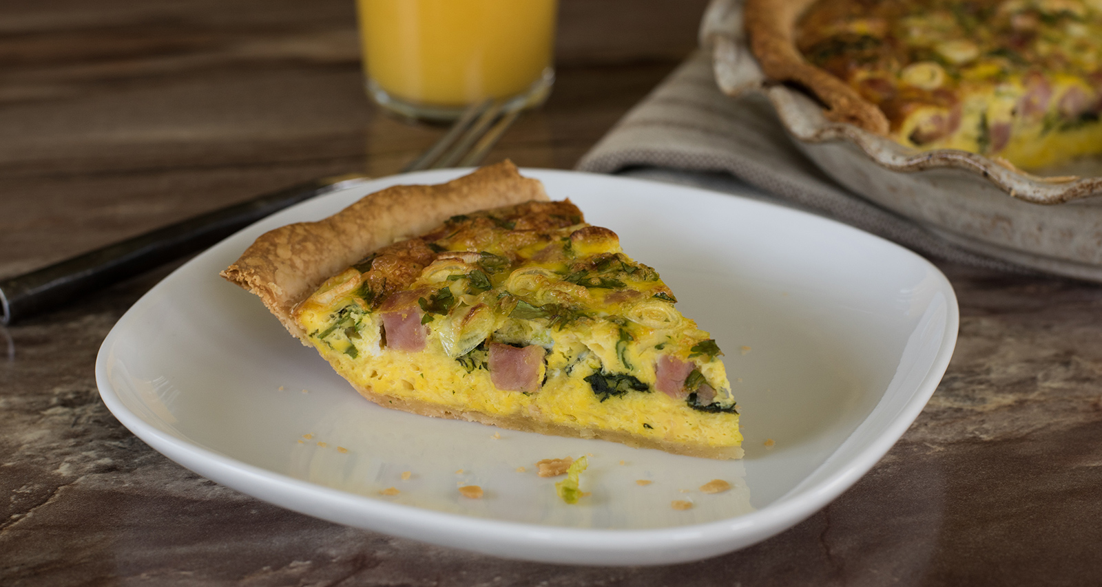 This Breakfast Delight Quiche combines classic flavors in an easy pie crust.