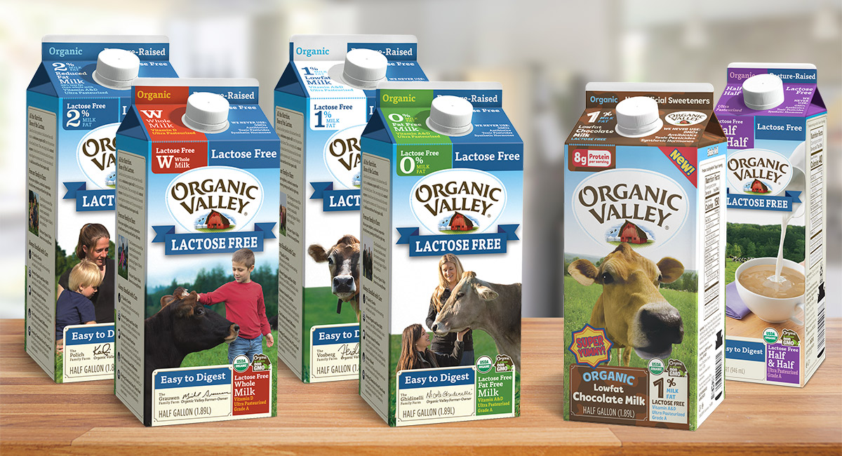 Organic Valley Lactose-free milk and half and half cartons on a wooden table.