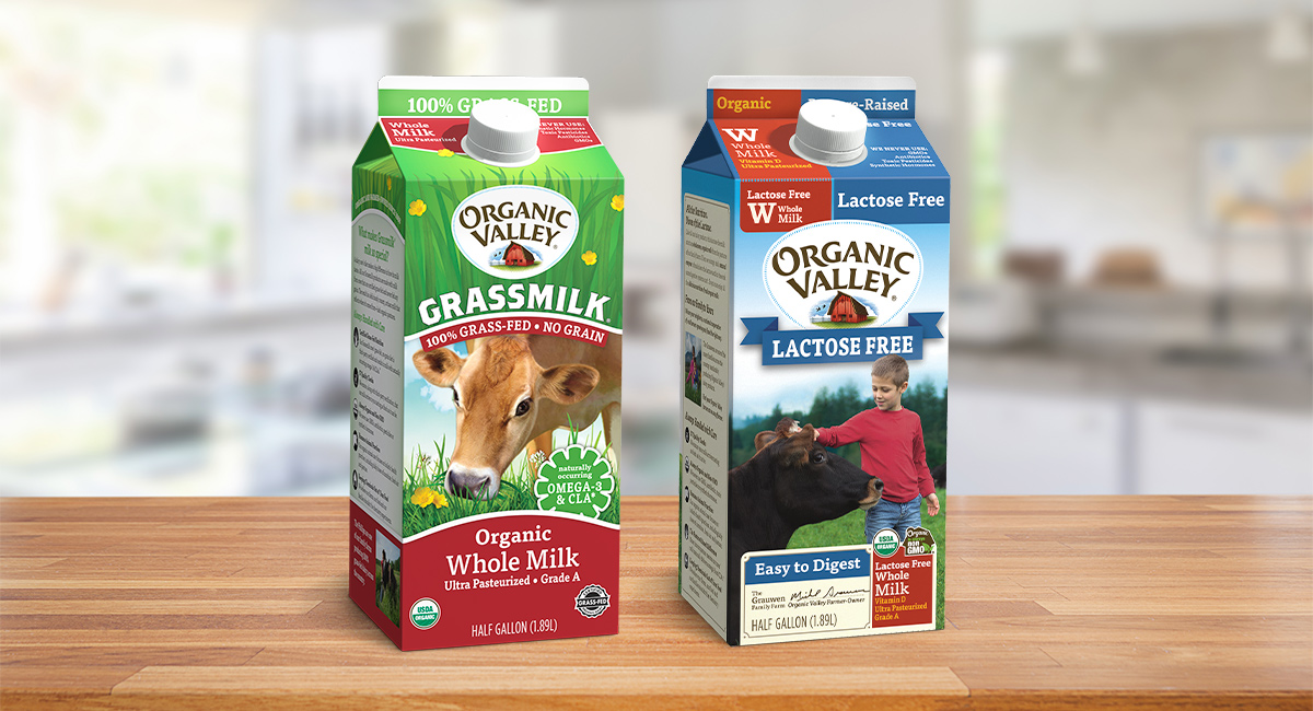 Organic Valley Grassmilk and Whole Lactose-Free Milk displayed on a table.