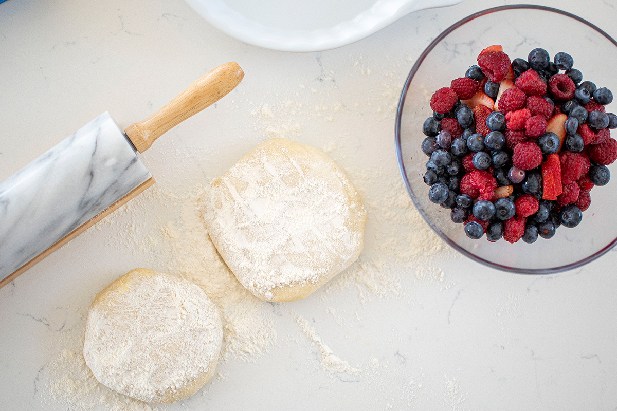 Pie crusts all ready to and be made into a triple berry pie.