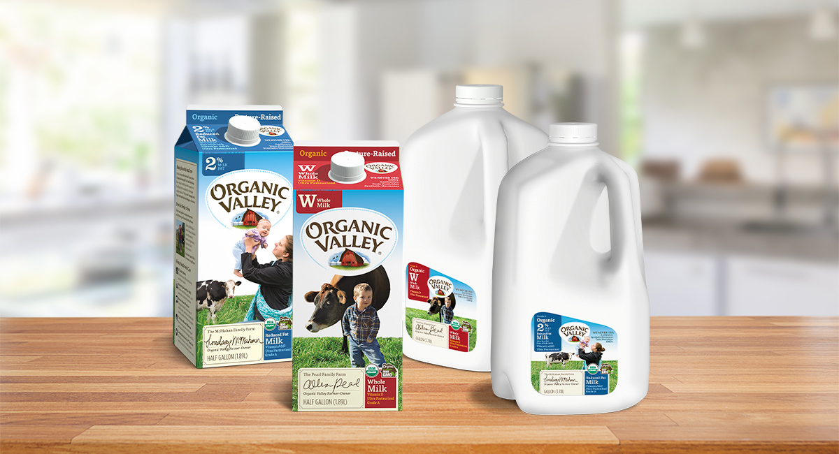 Organic Valley Whole and Reduced Fat Milk cartons on a countertop.