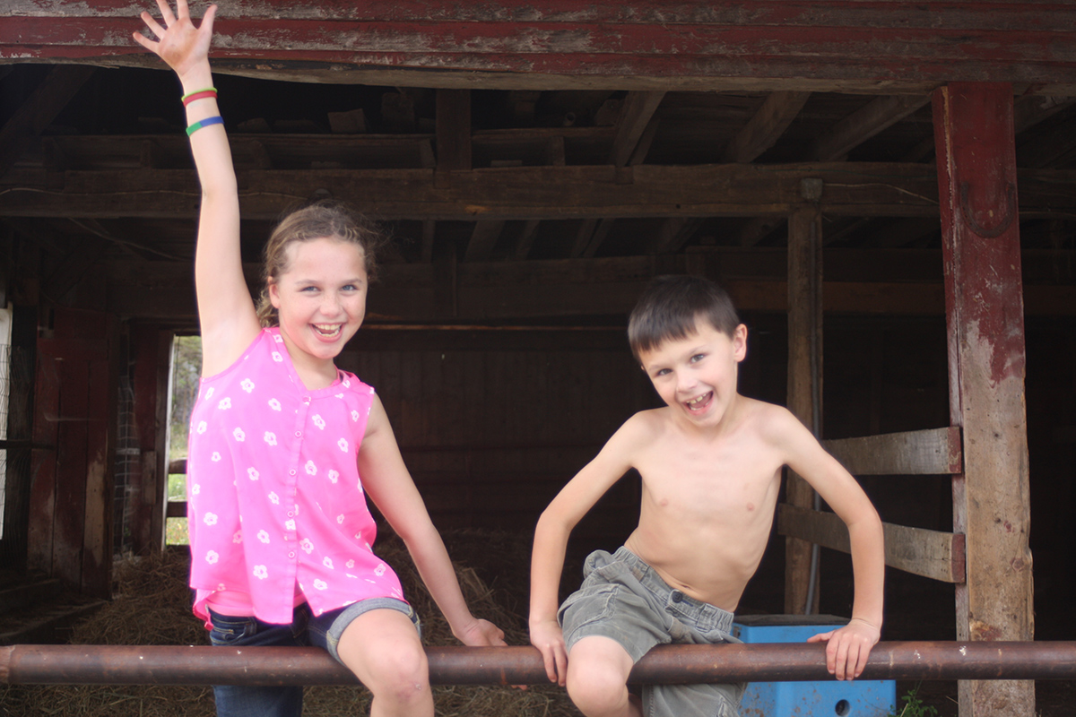 Russo kids pose on the family farm.