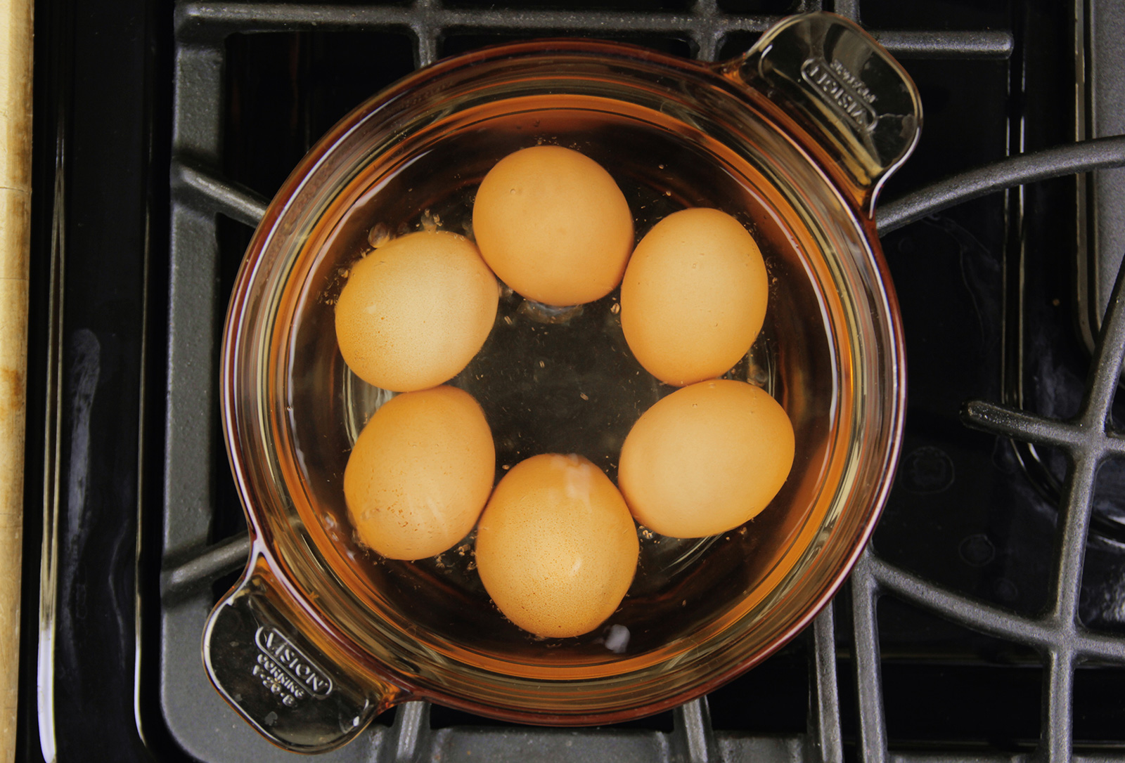 Eggs being hard-boiled on the stovetop.