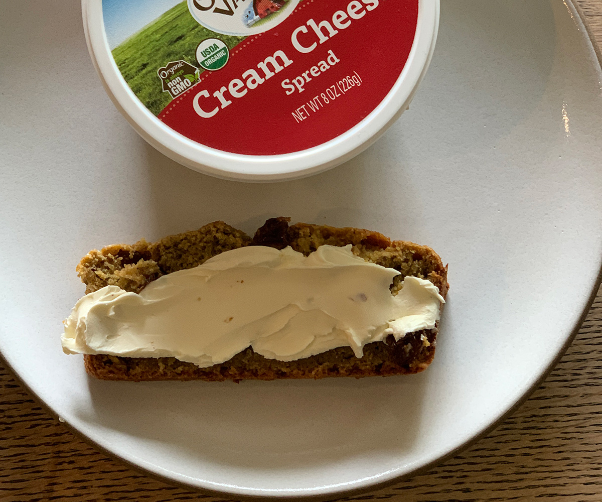 Organic Valley cream cheese spread on a slice of bread.