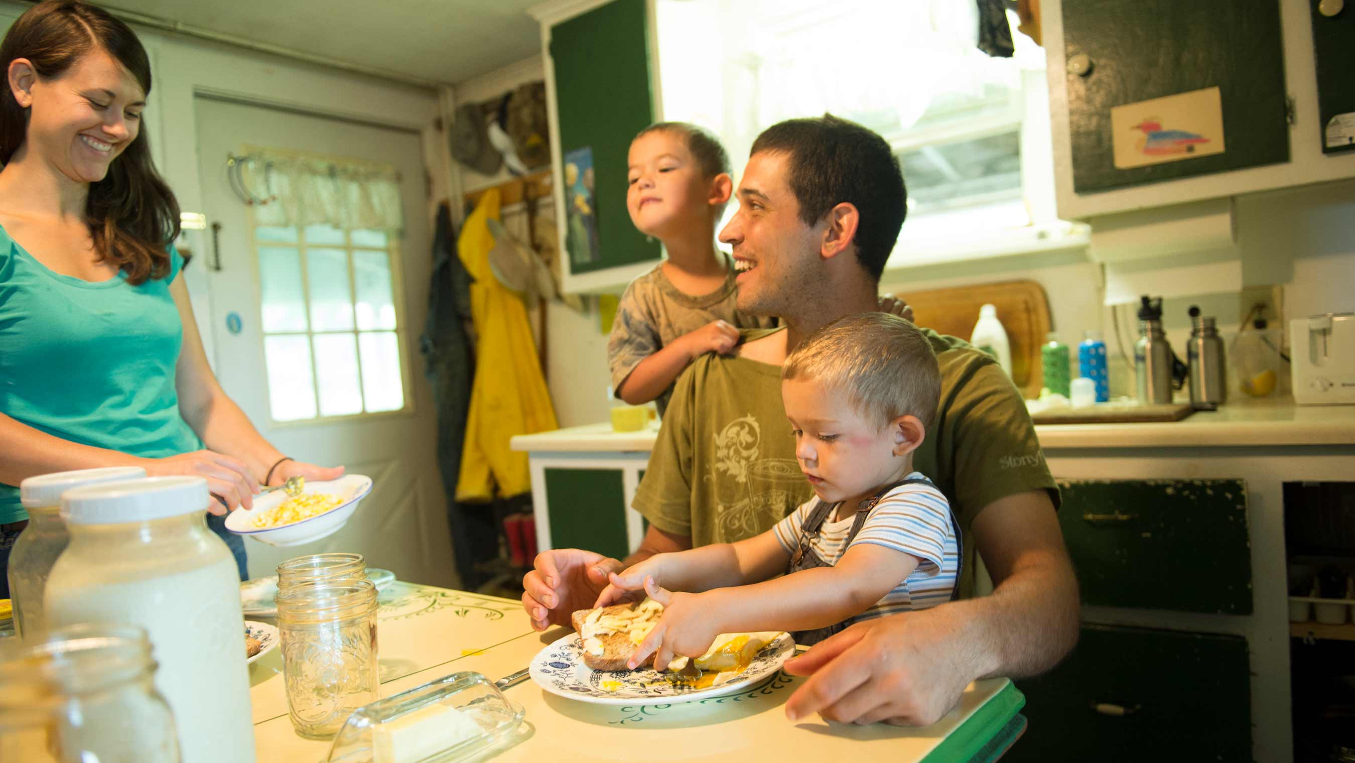 Emily Donegan serves her family a homemade meal in their kitchen.