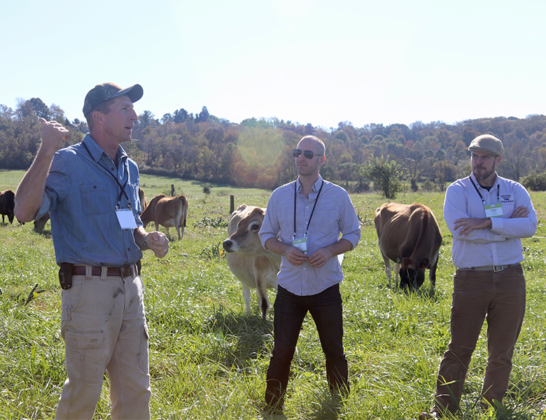Members of the media on an Organic Valley farm tour